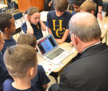 Bishop Deeley gets tech tips at Holy Cross